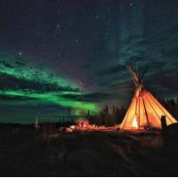 Viewing the Northern Lights from a teepee in the Northwest Territories | H Wang