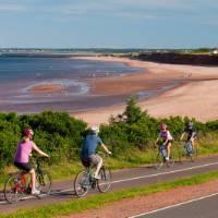 Cycling along the coast in Prince Edward Island National Park   Tourism PEI / John Sylvester
