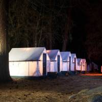 Tent cabin accommodation in Yosemite National Park at night | Curry House Yosemite National Park